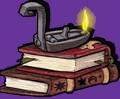 pile de livres et lampe à huile allumée
